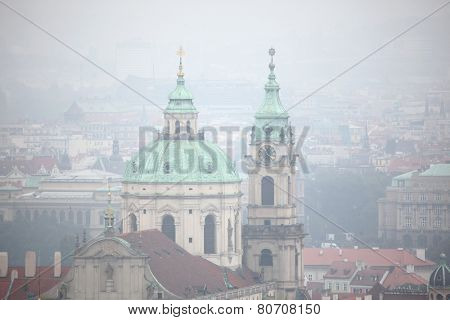Saint Nicholas Church in Mala Strana viewed from Petrin Hill in Prague, Czech Republic.