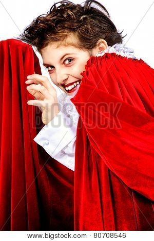 Expressive teen boy in a costume of vampire posing over white background.  Halloween. Isolated.