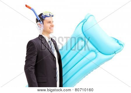 Man with suit and snorkel carrying swimming mattress isolated against white background