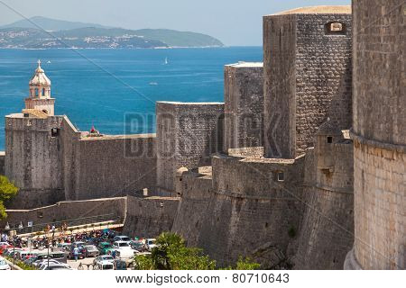 DUBROVNIK, CROATIA - MAY 27, 2014: Old city walls and Dominican church tower. City wall is one of most popular tourist attraction in Dubrovnik.
