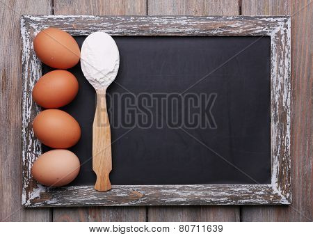 Blackboard menu blank on rustic wooden planks background