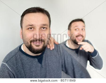 Man with himself alone as twins conceptual image