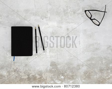 3D Rendering of Top view image of black notebook, two pencils and glasses with copyspace