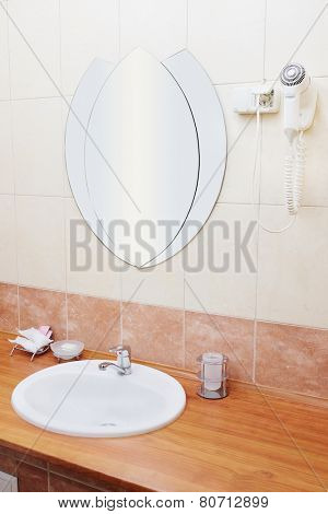 white sink with mirror