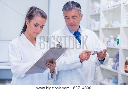 Pharmacist looking a medication for a prescription in the pharmacy