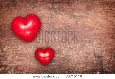 Two Textile Pendent Hearts