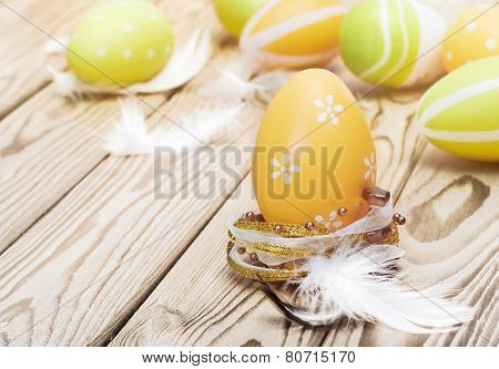 Easter Eggs And Plumelets On Wooden Background
