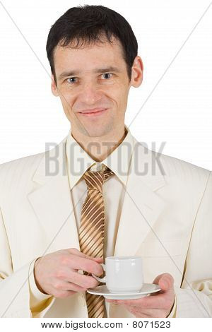 Happy Young Man With Cup Of Coffee