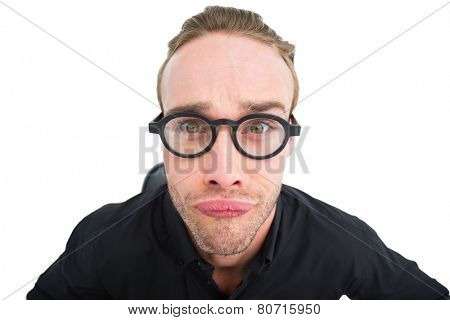 Portrait of geek making a face on white background