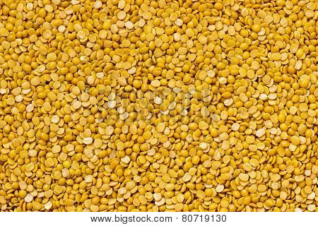 Golden-colored shiny split pigeon pea legume background
