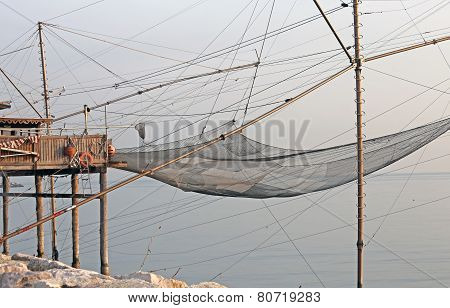 Fishing Nets Over The Stilt Houses Of Wood