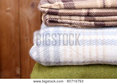 Warm plaids on rustic wooden background