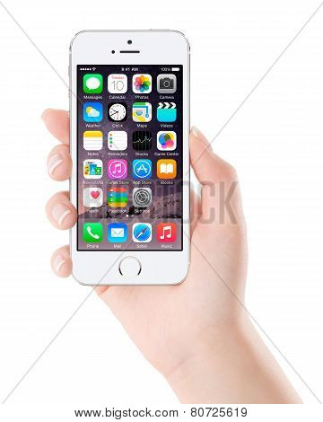 Apple Silver Iphone 5S Displaying Ios 8 In Female Hand, Designed By Apple Inc