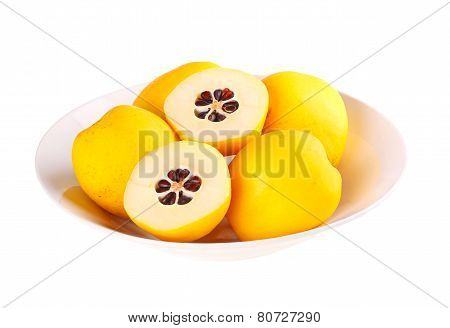 Bowl Of Flowering Quince Fruit Isolated Against White