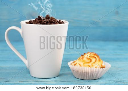 Cup Of Steaming Coffee And Cake