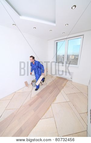 Master in white room where the laminate is laid