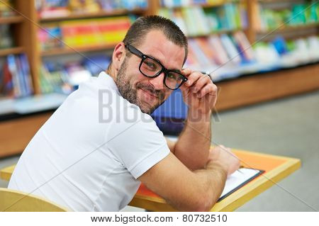 Portrait Of A Man With Glasses In A Bookstore