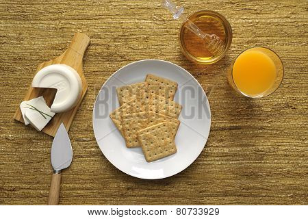 Crackers with cheese and honey