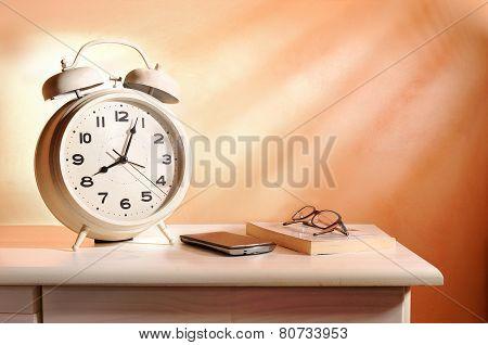Bedside Alarm Clock And Personal Belongings