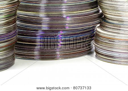 Three Stacks Of Colored Shiny Compact Discs