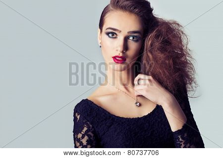 fashion photo of a beautiful girl with red lips, big eyes, bright makeup and stylish hair salon