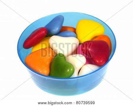 Sweet hearts in a blue plastic bowl