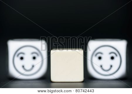 Blank Dice With Emoticon Dice (happy) In Background