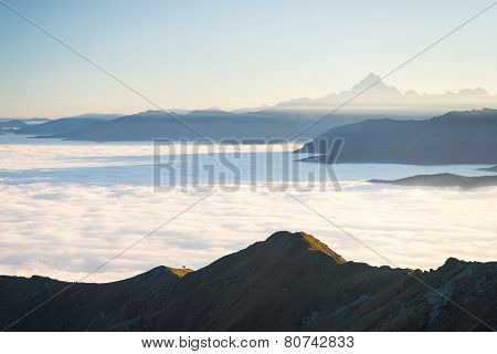 Misty Mountainscape At Sunset