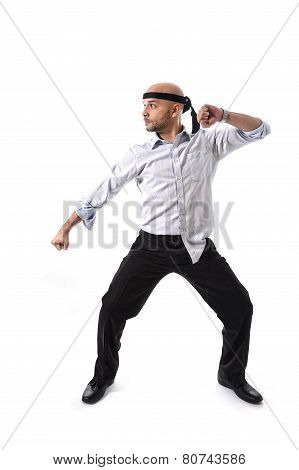 Messy Businessman In Kung Fu Karate Attack Pose In Business Competition Concept