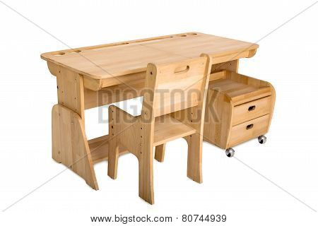 A wooden school desk with a bedside table and a chair on a white background