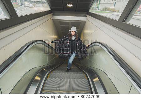 Beautiful Young Brunette Posing On Escalator