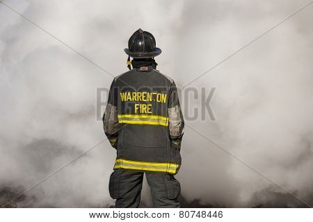 Firemen standing in front of smoke during a training session at the New Baltimore Fire Station in Ne