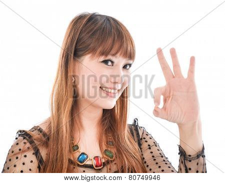 Half-length portrait of female okay gesturing,