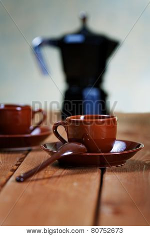 Cups Of Coffee And A Coffee Pot On A Rural Table