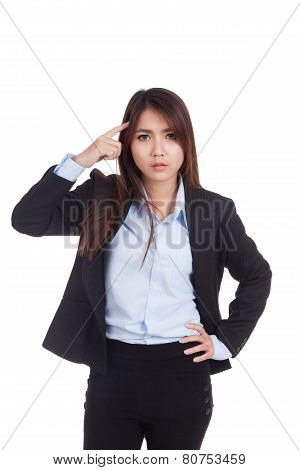 Fed Up Young Asian Businesswoman Point To Her Head