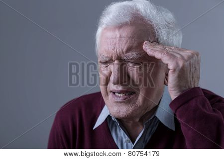 Elderly Man Having Headache
