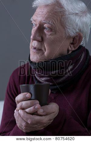 Ill Senior Man Wearing Scarf