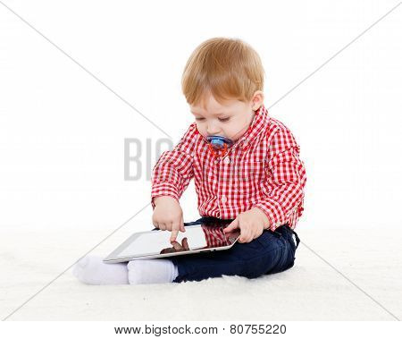 Small Baby With Computer Tablet.
