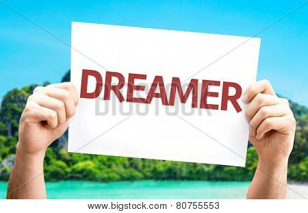 Dreamer card with a beach on background