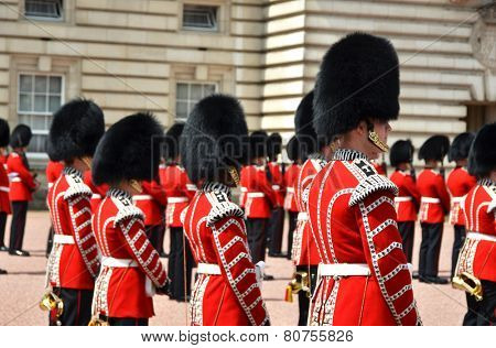 LONDON, UK - JUNE 12, 2014: British Royal guards perform the Changing of the Guard in Buckingham Palace