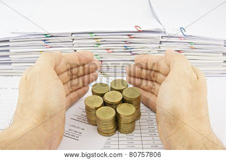 Hand Of Man Protect Stack Of Gold Coins