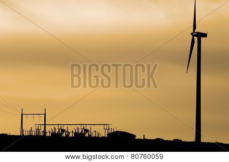 silhouette of windmills for renewable electric energy production