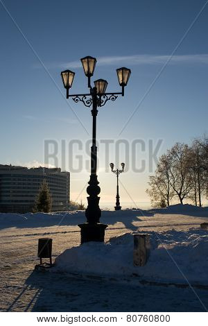 Lampost with Snow and Sun in Background