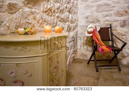 stone wall and retro chair in a bedroom