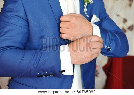 Man Puts Cufflinks