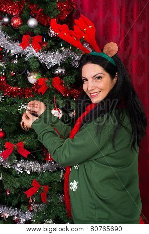 Christmas Woman Decorates Tree