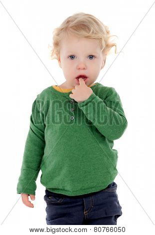 adorable baby with finger in mouth isolated on a white background