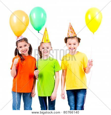 Portrait of three cute little girls with bright balloons and party hat - isolated on a white.