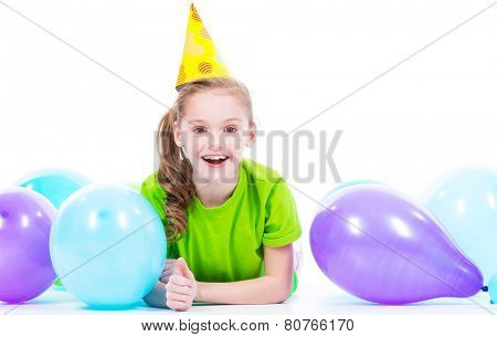 Happy smiling girl in green t-shirt  lying on the floor with colorful balloons - isolated on a white.