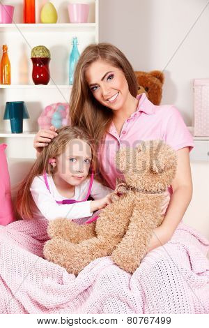 Mother With Sick Child at home